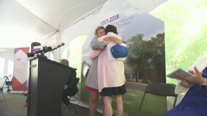 Teresa Dellar, co-founder of the West Island Palliative Care Residence, hugs someone at the groundbreaking ceremony for an expanded facility
