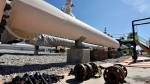 In this June 8, 2017, file photo, fresh nuts, bolts and fittings are ready to be added to the east leg of the pipeline near St. Ignace, Mich., as Enbridge prepares to test the east and west sides of the Line 5 pipeline under the Straits of Mackinac in Mackinaw City, Mich. (Dale G Young/Detroit News via AP)