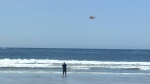 A search and rescue helicopter is seen off the shore of Tofino's Chesterman Beach Friday, June 15, 2018. (CTV Vancouver Island)