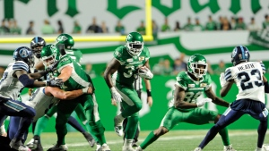 Saskatchewan Roughriders running back Jerome Messam picks up yards during second half season opener CFL action at Mosaic Stadium in Regina on Friday, June 15, 2018. THE CANADIAN PRESS/Mark Taylor