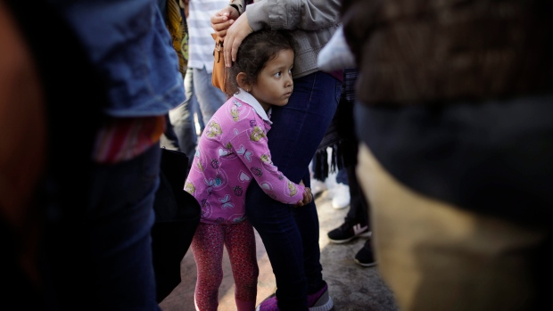 Children cry for their parents after being separated at the border