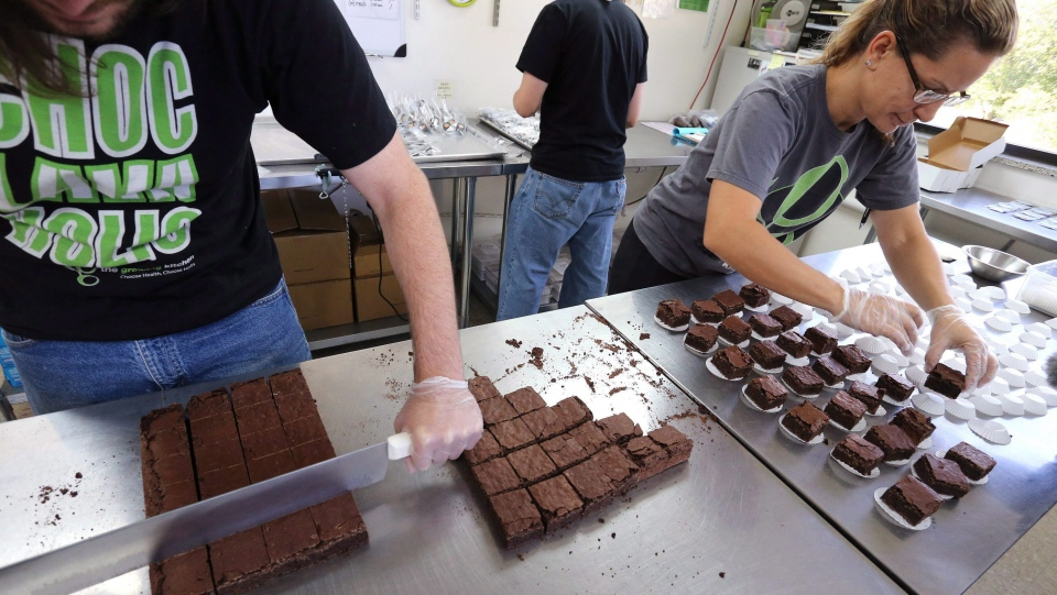 In this 2014 file photo, pot-infused brownies are divided and packaged at The Growing Kitchen in Boulder, Colo. Cannabis edibles will be sold in Canada no later than Oct. 17, 2019. (THE CANADIAN PRESS/AP /Brennan Linsley)