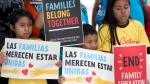 In this June 1, 2018, file photo, children hold signs during a demonstration in front of the Immigration and Customs Enforcement offices in Miramar, Fla. (AP Photo/Wilfredo Lee, File)