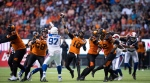 B.C. Lions quarterback Jonathon Jennings (10) passes as the offensive line holds off the Montreal Alouettes during the second half of a CFL football game in Vancouver, on Saturday June 16, 2018. THE CANADIAN PRESS/Darryl Dyck