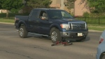 A seven-year-old girl was struck by a car after police say she was crossing the road against the lights.