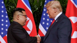 U.S. President Donald Trump shakes hands with North Korea leader Kim Jong Un at the Capella resort on Sentosa Island Tuesday, June 12, 2018 in Singapore. (AP / Evan Vucci)