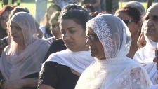 Woman at Surrey vigil against violence