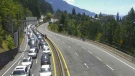 This image from a DriveBC web cam along the Sea to Sky highway shows the northbound lanes backed up because of a crash just north of Lions Bay.