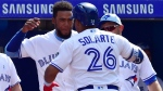 Toronto Blue Jays third baseman Yangervis Solarte (26) celebrates his solo home run against the Washington Nationals with Teoscar Hernandez during eighth inning interleague baseball action in Toronto on Sunday, June 17, 2018. (THE CANADIAN PRESS/Frank Gunn)