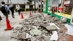 Debris of damaged walls are scattered following an earthquake, in Ibaraki, Osaka, Monday, June 18, 2018. A strong earthquake knocked over walls and set off scattered fires around the city of Osaka in western Japan on Monday morning. (Yosuke Mizuno/Kyodo News via AP)
