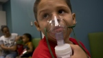 Yahir Garcia receives one of his two daily treatments for asthma at a medical centre in San Juan, Puerto Rico on May 29, 2018. (AP Photo/Ramon Espinosa)