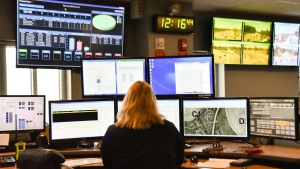 FILE - In this March 15, 2018, file photo, a dispatcher works at a desk station with a variety of screens used by those who take 911 emergency calls in Roswell, Ga. (AP Photo/Lisa Marie Pane, File)