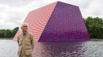 Artist Christo attends the unveiling of his first U.K. outdoor exhibit, The London Mastaba, on the Serpentine Lake in Hyde Park, central London, Monday June 18, 2018. (Dominic Lipinski/PA via AP)