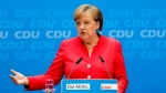 German Chancellor Angela Merkel attends a news conference after a leaders meetings of her Christion Democratic Union party at the party's headquarters in Berlin, Monday, June 18, 2018. (AP Photo/Markus Schreiber)
