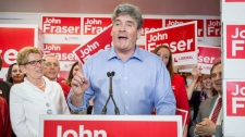 John Fraser speaks as he introduces Ontario Liberal leader Kathleen Wynne speaks during a campaign stop in his riding, Ottawa South, the riding of former riding of Premier Dalton McGuinty in Ottawa on Wednesday, May 7, 2014. Ontarians go to the polls for a provincial election on June 12, 2014. (THE CANADIAN PRESS/Justin Tang)