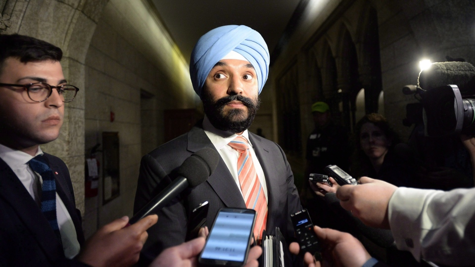 Minister of Innovation, Science and Economic Development Navdeep Bains speaks to reporters on Parliament Hill in Ottawa on Monday, June 4, 2018. (THE CANADIAN PRESS/Justin Tang)