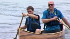 Launching a cedar strip canoe