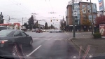 This still from a dashcam video shows a light-coloured Audi just before it crashes into a red Suzuki in Vancouver.