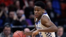 In this March 15, 2018, file photo, Kentucky guard Shai Gilgeous-Alexander moves the ball against Davidson during a first-round game in the NCAA men's college basketball tournament, in Boise, Idaho. (THE CANADIAN PRESS/AP/Ted S. Warren)