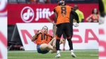 B.C. Lions' Marcell Young (8) knocks down a spectator that ran onto the field of play during the first half of a CFL football game against the Montreal Alouettes in Vancouver, on Saturday, June 16, 2018. THE CANADIAN PRESS/Darryl Dyck