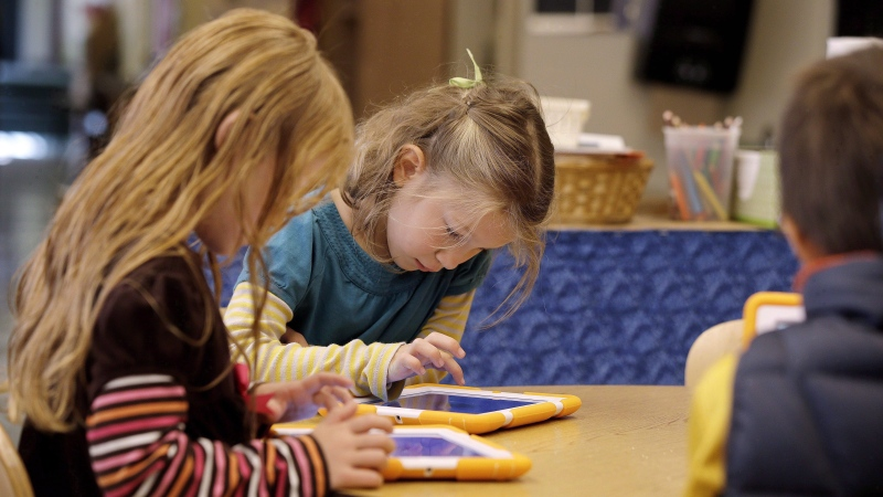 Children work with their ScratchJr programs on iPads at the Eliot-Pearson Children's School in Medford, Mass., Sept.18, 2014. THE CANADIAN PRESS/ AP/Stephan Savoia