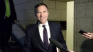Minister of Finance Bill Morneau arrives for a cabinet meeting on Parliament Hill in Ottawa on June 4, 2018. The federal ethics commissioner says Finance Minister Bill Morneau did not violate any conflict of interest laws in sponsoring a pension bill last year. Morneau found himself in hot water when he introduced pension-reform legislation, which critics insisted would benefit Morneau Shepell, his family company. THE CANADIAN PRESS/Justin Tang