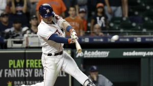 Houston Astros' Alex Bregman hits a game-winning double to score two runs against the Tampa Bay Rays during the ninth inning of a baseball game in Houston on Monday, June 18, 2018. (AP Photo/David J. Phillip)
