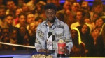 "Chadwick Boseman accepts the award for best performance in a movie for ""Black Panther"" at the MTV Movie and TV Awards at the Barker Hangar in Santa Monica, Calif. on Saturday, June 16, 2018. (Matt Sayles/Invision/AP)"