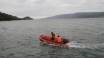 Indonesian search and rescue team on the boat search for a ferry carrying about 80 passengers which sank on Monday, in Toba lake, North Sumatera, Indonesia, Tuesday, June 19, 2018. (AP Photo/ Lazuardy Fahmi)