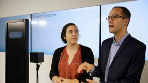 Noa Ovadia, left, and Dan Zafrir, right, prepare for their debate against the IBM Project Debater, Monday, June 18, 2018, in San Francisco. (AP Photo/Eric Risberg)