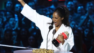 "In this Saturday, June 16, 2018, photo, Tiffany Haddish accepts the best comedic performance award for ""Girls Trip"" at the MTV Movie and TV Awards at the Barker Hangar in Santa Monica, Calif. (Photo by Matt Sayles/Invision/AP)"