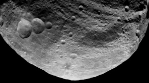 This undated image released by NASA and taken by the NASA Dawn spacecraft shows the south pole of the giant asteroid Vesta. Vesta is much larger than the new asteroid that shot by Earth this Friday, 2019 NJ2. (AP Photo/NASA)