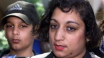 Suman Virk, mother of murdered teen Reena Virk, and her son Aman, left, talk to reporters outside court in Vancouver Thursday, April 20, 2000 following the sentencing of Kelly Ellard who was convicted in the killing. THE CANADIAN PRESS/Chuck Stoody