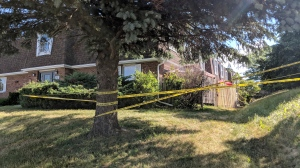Police investigate a homicide on Courtland Avenue East in Kitchener on Tuesday, June 19, 2018. (Marta Czurylowicz / CTV Kitchener)