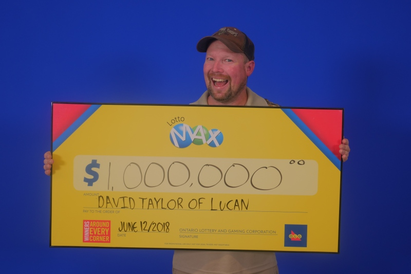 David Taylor of Lucan is all smiles as he picks up his $1 million lottery prize. (Photo by OLG)