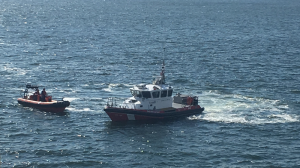A BC Ferries rescue vessel and Canadian Coast Guard boat respond to reports of a man overboard Monday morning. (Photo: Jason James)
