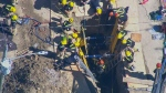Crews work to pull out a worker trapped under heavy machinery at a work site in Oshawa, on Tuesday, June 19, 2018.