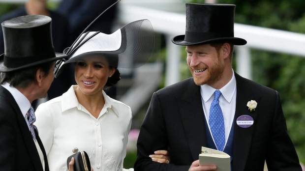 Prince Harry and Meghan, Duchess of Sussex, arrive on the first day of the Royal Ascot horse race meeting in Ascot, England, Tuesday, June 19, 2018. (AP Photo/Tim Ireland)