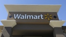 This Sept. 19, 2013, file photo, shows the sign of a Walmart store in San Jose, Calif. (AP Photo/Jeff Chiu, File)