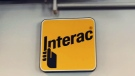 An Interac sign is seen at the company's innovation hub in Kitchener on Tuesday, June 19, 2018.
