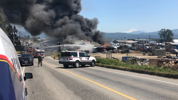 A large fire is seen at an auto recycling business in Abbotsford on June 19, 2018.