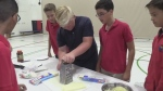 Students use cheese grater
