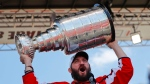 Washington Capitals forward Alex Ovechkin (8), of Russia, holds up the Stanley Cup for fans to see during the NHL hockey team's Stanley Cup victory celebration at the National Mall in Washington, Tuesday, June 12, 2018. (AP Photo/Pablo Martinez Monsivais)