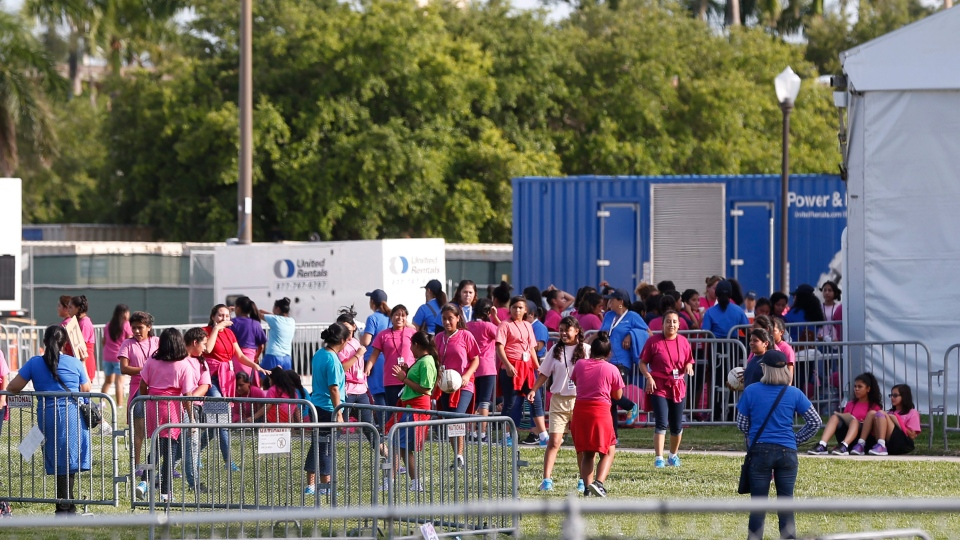 Immigrant children play outside a former Job Corps site that now houses them, Monday, June 18, 2018, in Homestead, Fla. It is not known if the children crossed the border as unaccompanied minors or were separated from family members. (AP Photo/Wilfredo Lee)