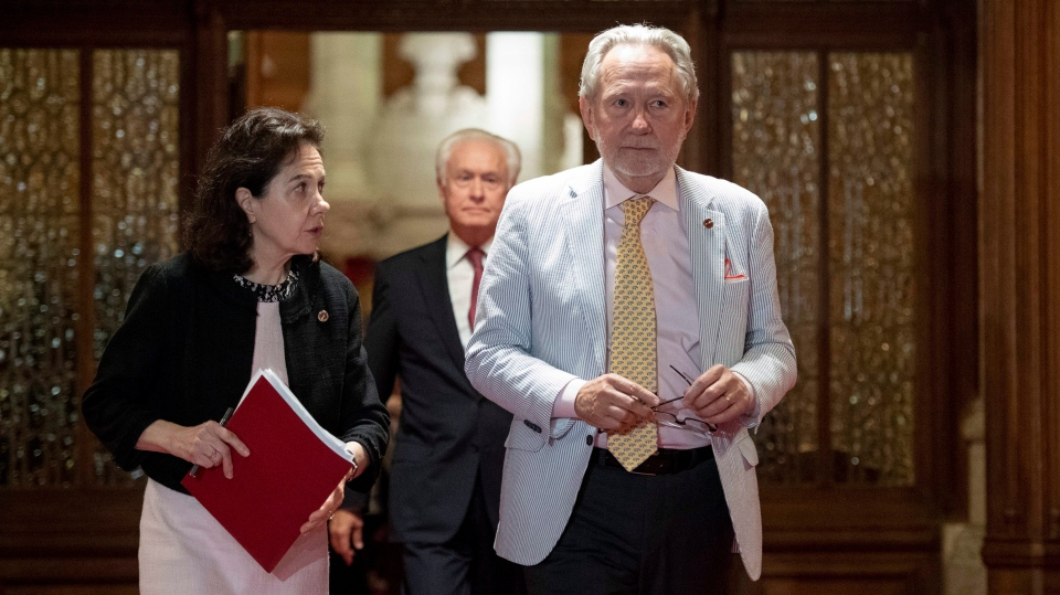 Sen. Peter Harder, Government Representative in the Senate, leaves the Senate Chamber along with Sen. Raymonde Saint-Germain after the vote on Bill C-45, the Cannabis Act in the Senate on Parliament Hill in Ottawa on Tuesday, June 19, 2018. THE CANADIAN PRESS/Justin Tang