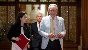 Sen. Peter Harder, Government Representative in the Senate, leaves the Senate Chamber along with Sen. Raymonde Saint-Germainm after the vote on Bill C-45, the Cannabis Act in the Senate on Parliament Hill in Ottawa on Tuesday, June 19, 2018. THE CANADIAN PRESS/Justin Tang