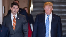 Speaker of the House Paul Ryan, R-Wis., left, walks with President Donald Trump as they head to a meeting of House Republicans to discuss a GOP immigration bill at the Capitol in Washington, Tuesday, June 19, 2018. (AP / J. Scott Applewhite)