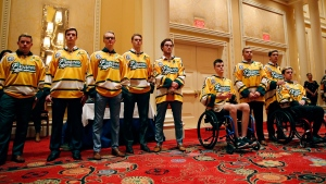 Members of the Humboldt Broncos hockey team attend a news conference Tuesday, June 19, 2018, in Las Vegas. The Saskatchewan junior hockey team's bus was in a collision with a semi-trailer on a rural highway in April resulting in multiple fatalities and injuries. (AP / John Locher)