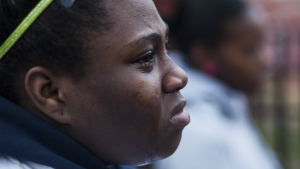 Julie Williams weeps at a vigil for her cousin, 14-year-old Endia Martin, in Chicago on April 30, 2014. (Jessica Koscielniak/Chicago Sun-Times via AP)