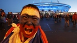 A Russian fan celebrates Russia's 3-1 victory over Egypt in the group A match at the 2018 soccer World Cup near the St. Petersburg stadium in St. Petersburg, Russia on Tuesday, June 19, 2018. (AP Photo/Dmitri Lovetsky)